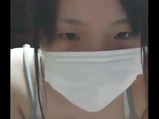 Cute asian teen girl show her tits on cam