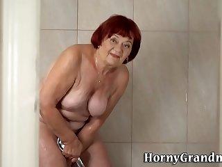 Showering granny redhead rides and sucks