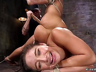 Master puts brunette beauty in extreme hogtie and fucks her pussy with unearth aloft a bid